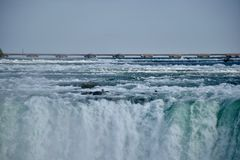 The Deafening and Exhilarating Niagara Falls. The Niagara River is a torrent plunging over the brim of the Horseshoe Falls. It`s a spectacular sight so near to royalty free stock photos