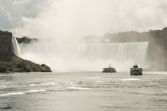 NIAGRA, ONTARIO Canada 06.09.2017 Tourists aboard the Maid of the Mist boat at the Niagara Falls USA royalty free stock photo