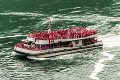 NIAGRA, ONTARIO Canada 06.09.2017 Tourists aboard the Maid of the Mist boat at the Niagara Falls USA royalty free stock images