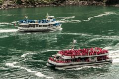 NIAGRA, ONTARIO Canada 06.09.2017 Tourists aboard the Maid of the Mist boat at the Niagara Falls USA stock images