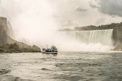 NIAGRA, ONTARIO Canada 06.09.2017 Tourists aboard the Maid of the Mist boat at the Niagara Falls USA royalty free stock photography