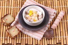 Nian gao dumplings and taro in coconut cream. After the ceremony, then use nian gao in respect Chinese festival to be delicious dessert. Nian gao dumplings and Stock Images