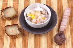 Nian gao dumplings and taro in coconut cream. Royalty Free Stock Photo