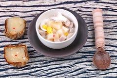 Nian gao dumplings and taro in coconut cream. Royalty Free Stock Photography