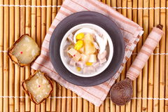 Nian gao dumplings and taro in coconut cream. After the ceremony, then use nian gao in respect Chinese festival to be delicious dessert. Nian gao dumplings and Royalty Free Stock Images