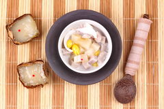 Nian gao dumplings and taro in coconut cream. After the ceremony, then use nian gao in respect Chinese festival to be delicious dessert. Nian gao dumplings and Royalty Free Stock Image