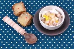 Nian gao dumplings and taro in coconut cream. Royalty Free Stock Images