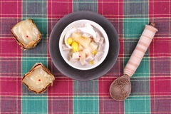 Nian gao dumplings and taro in coconut cream. Stock Photography