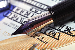 Nib pen and dollar Stock Images