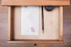Nib pen, ink, vintage envelope in open drawer Royalty Free Stock Photo