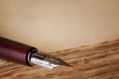Nib Pen on Old Book with Copy Space Royalty Free Stock Images