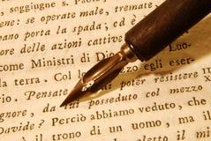 Nib (pen) over an old book Royalty Free Stock Photos