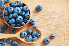 Nic blueberries in bowl on wooden background. Stock Photo