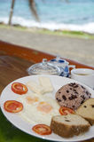 Nicaragua breakfast typical. Nicaraguan typical breakfast gallo pinto rice beans fried eggs cheese coconut bread by the sea photographed in Nicaragua Corn Island royalty free stock photography