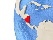 Nicaragua on 3D globe. Map of Nicaragua on globe with watery blue oceans and landmass with visible country borders. 3D illustration stock illustration