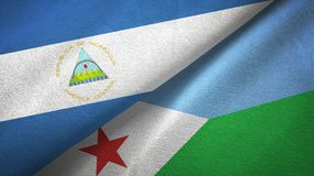 Nicaragua and Djibouti two flags textile cloth, fabric texture. Nicaragua and Djibouti two folded flags together royalty free stock photos