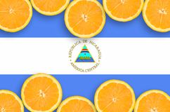 Nicaragua flag in citrus fruit slices horizontal frame. Nicaragua flag in horizontal frame of orange citrus fruit slices. Concept of growing as well as import royalty free illustration