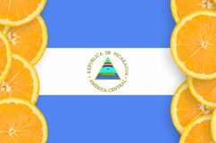 Nicaragua flag in citrus fruit slices vertical frame. Nicaragua flag in vertical frame of orange citrus fruit slices. Concept of growing as well as import and stock image