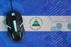 Nicaragua flag and computer mouse. Digital threat, illegal actions on the Internet. Nicaragua flag and modern backlit computer mouse. The concept of digital royalty free stock photos