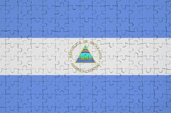 Nicaragua flag is depicted on a folded puzzle royalty free stock photo