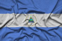 Nicaragua flag is depicted on a sports cloth fabric with many folds. Sport team banner. Nicaragua flag is depicted on a sports cloth fabric with many folds stock photography