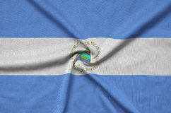 Nicaragua flag is depicted on a sports cloth fabric with many folds. Sport team banner. Nicaragua flag is depicted on a sports cloth fabric with many folds royalty free stock images