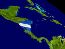 Nicaragua with flag on Earth Stock Images