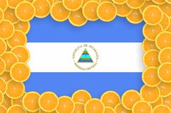 Nicaragua flag in fresh citrus fruit slices frame. Nicaragua flag in frame of orange citrus fruit slices. Concept of growing as well as import and export of royalty free illustration