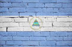 Nicaragua flag is painted onto an old brick wall royalty free stock images