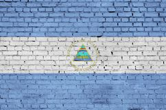 Nicaragua flag is painted onto an old brick wall royalty free stock photos