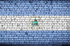 Nicaragua flag is painted onto an old brick wall vector illustration