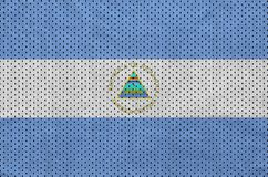 Nicaragua flag printed on a polyester nylon sportswear mesh fabr. Ic with some folds stock image