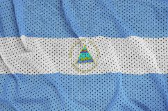 Nicaragua flag printed on a polyester nylon sportswear mesh fabr. Ic with some folds stock images