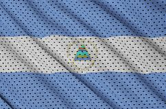 Nicaragua flag printed on a polyester nylon sportswear mesh fabr. Ic with some folds royalty free stock images