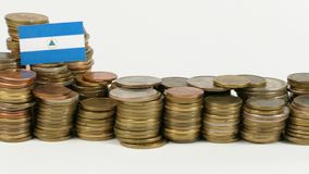 Nicaragua flag with stack of money coins. Nicaragua flag waving with stack of money coins stock video footage
