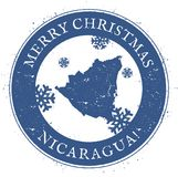 Nicaragua map. Vintage Merry Christmas Nicaragua. Nicaragua map. Vintage Merry Christmas Nicaragua Stamp. Stylised rubber stamp with county map and Merry Stock Photo