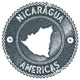 Nicaragua map vintage stamp. Retro style handmade label, badge or element for travel souvenirs. Dark blue rubber stamp with country map silhouette. Vector Stock Photo