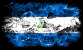 Nicaragua smoke flag on a black background.  stock image