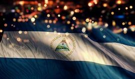 Nicaragua-Staatsflagge-Licht-Nacht-Bokeh-Zusammenfassungs-Hintergrund Stockfotos