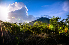 Nicaragua Volcano. Sun behind clouds next to volcano Stock Photography