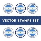 Nicaraguan flag rubber stamps set. National flags grunge stamps. Country round badges collection Royalty Free Stock Images