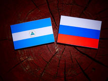 Nicaraguan flag with Russian flag on a tree stump. Nicaraguan flag with Russian flag on a tree stump Stock Photography