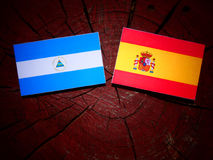 Nicaraguan flag with Spanish flag on a tree stump. Nicaraguan flag with Spanish flag on a tree stump Royalty Free Stock Images