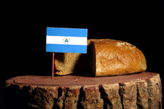 Nicaraguan flag on a stump with bread.  Stock Photo