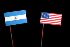 Nicaraguan flag with USA flag  on black. Background Royalty Free Stock Image