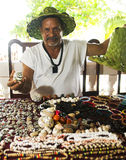 Nicaraguan jewelry artist selling necklaces bracelets earrings a. T resort Corn Island Nicaragua Central America  wearing hat made from palm tree leaves Stock Photo