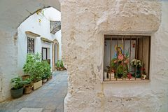 Nicchia with altars in the alleys of the historic center of Gall. GALLIPOLI, ITALY - CIRCA APRIL, 2015: Puglia`s religious affairs, niches with altars in the Stock Images