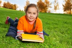 Nice 8 years old girl laying in the park Royalty Free Stock Image