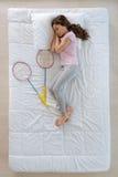 Nice active girl dreaming of playing badminton Stock Photo