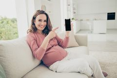 Nice adorable lovely cheerful positive optimistic glad pregnant stock photo